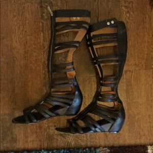 Black gladiator sandals with zipper front
